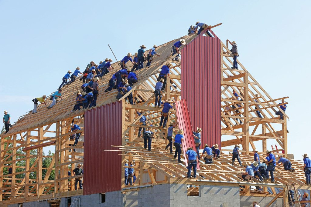 Amish workers erecting a barn
